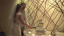 image of bride and groom cutting wedding cake