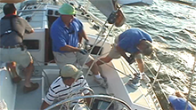 image of sailboat racing crew